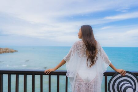 Portrait beautiful young asian woman looking sea beach ocean for relax in holiday vacation travel concept