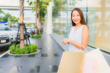 Portrait beautiful young asian woman happy and smile with shopping bag from department store mall Banco de Imagens - 135534867