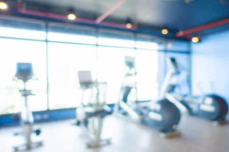 Abstract blur gym interior with fitness equipment