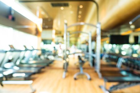 Abstract blur fitness equipment in gym interior room for background
