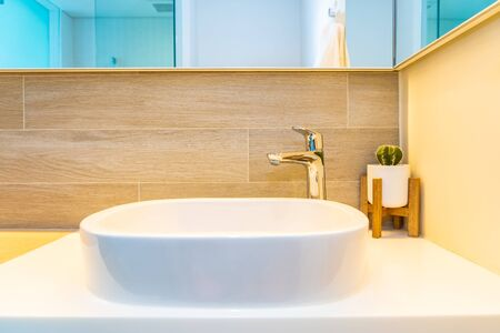 Water facuet and white sink decoration interior of bathroom and toilet