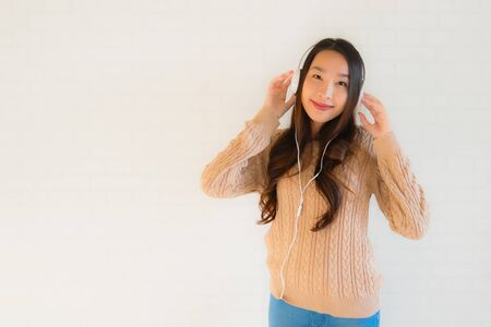 Portrait beautiful young asian women happy enjoy with listen music and copy space Stock Photo