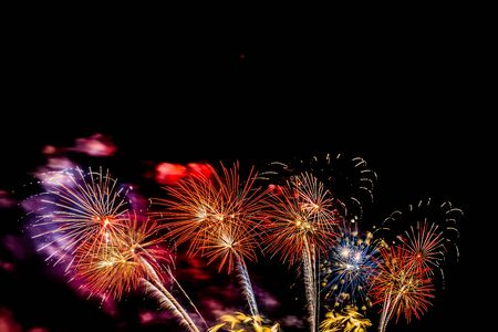 Beautiful colorful firework display at night for celebrate in anniversary Фото со стока
