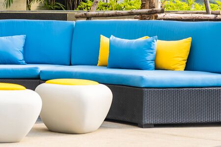 Outdoor patio in the garden with sofa chair and pillow decoration for take a relax