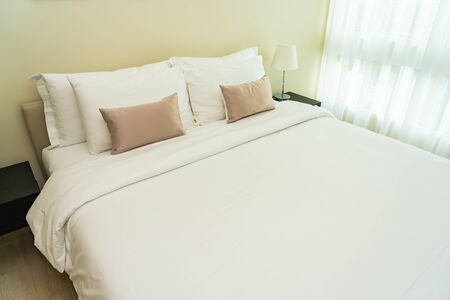 White comfortable pillow on bed decoration interior of bedroom