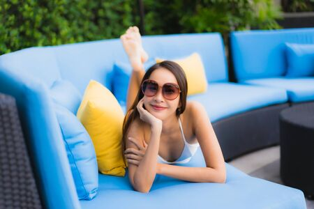 Portrait beautiful young asian women happy smile relax around outdoor swimming pool in hotel resort for travel vacation