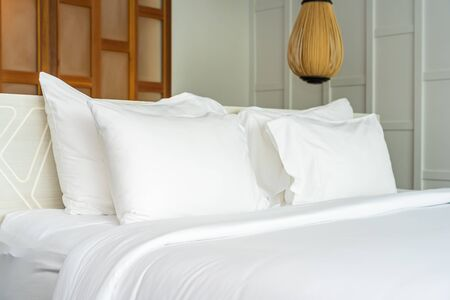 Pillow on bed decoration interior of bedroom interior with light lamp