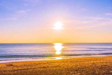 Beautiful tropical nature beach sea ocean at sunset or sunrise time for travel