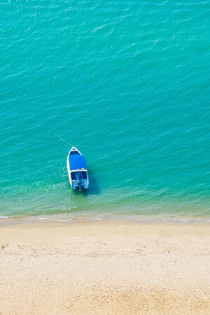 Speed boat on beautiful tropical sea ocean nearly beach for leisure vacation