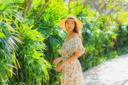 Portrait beautiful young asian woman walking with happy enjoy around outdoor garden view