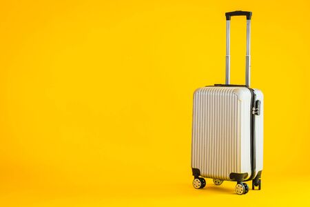 Gray color luggage or baggage bag use for transportation travel and leisure on yellow isolated background