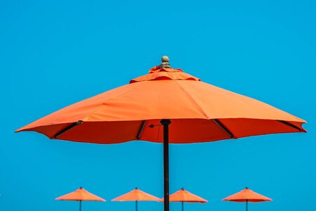 Umbrella with beautiful blue sky background nearly sea ocean beach for travel vacation concept