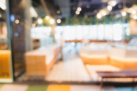 Centre commercial flou abstrait et défocalisation à l'intérieur du grand magasin pour le fond