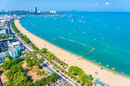 Beautiful tropical beach sea ocean bay around white cloud blue sky and architecture building in Pattaya city Thailand