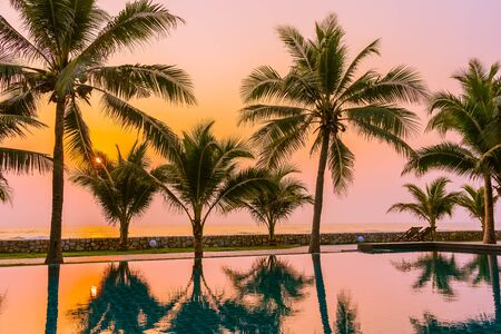 Beautiful nature with palm tree around outdoor swimming pool in hotel resort nearly sea ocean beach 스톡 콘텐츠 - 146859882