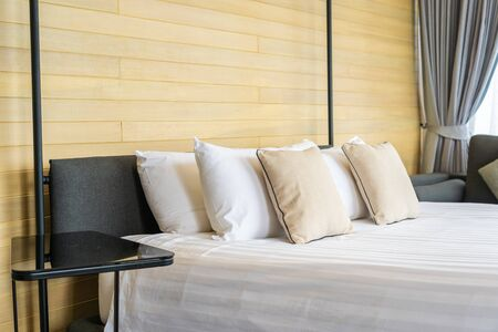 White comfortable pillow on bed decoration interior of bed room in hotel resort Reklamní fotografie