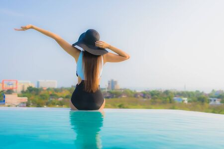 Portrait beautiful young asian woman happy smile relax around outdoor swimming pool in hotel resort for travel vacation Stok Fotoğraf