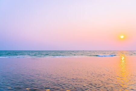 Beautiful tropical nature of sea ocean beach around outdoor swimming pool at sunset or sunrise time for leisure travel and vacation Stok Fotoğraf
