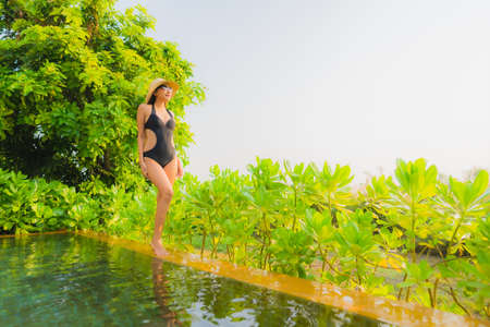 Portrait beautiful young asian woman   relax in swimming pool at hotel resort for leisure vacation trip