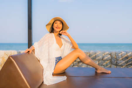 Portrait young asian woman happy smile relax around beach sea ocean for travel vacation
