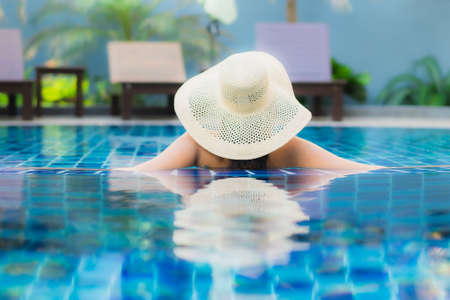 Portrait beautiful young asian woman relax around swimming pool in hotel resort for leisure in vacation