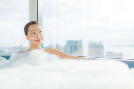 Portrait beautiful young asian woman relax enjoy in bathtub in bathroom interior Imagens