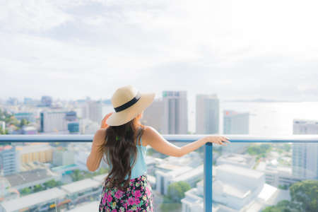 Portrait beautiful young asian woman around balcony with outdoor view