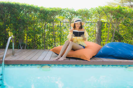 Portrait beautiful young asian woman relax enjoy around outdoor swimming pool in holiday vacation