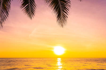 Beautiful landscape of sea ocean with silhouette coconut palm tree at sunset or sunrise for nature background