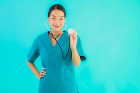 Portrait beautiful young asian doctor asian woman work at clinic or hospital on blue isolated background