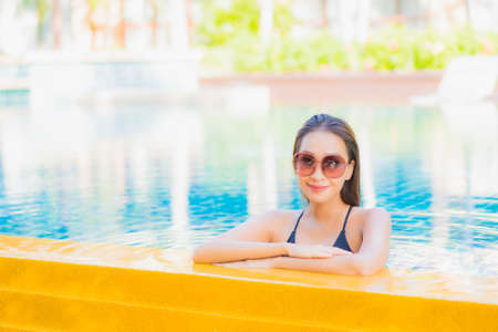 Portrait beautiful young asian woman relax leisure around swimming pool in vacation travel Imagens