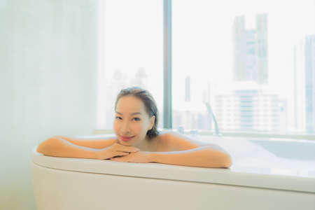 Portrait beautiful young asian woman relax enjoy in bathtub interior Imagens