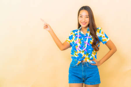 Portrait beautiful young asian woman wear colorful shirt for songkran festival on color background