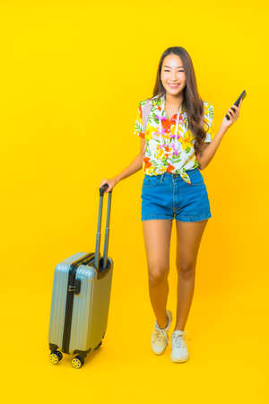 Portrait beautiful young asian woman wear colorful shirt backpacker or luggage ready for travel