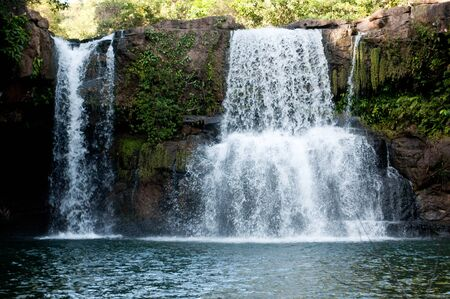 falling tide:  waterfall koh kod thailand Stock Photo