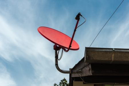 Red Satellite dish on the roof photo