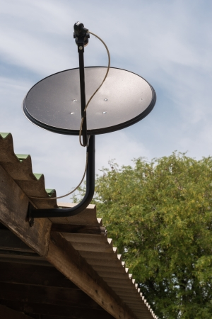 Black Satellite dish on the roof photo