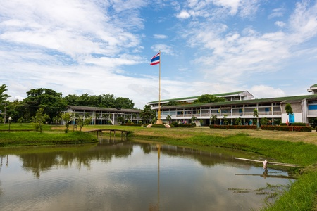 Thailand flag in the school and blue sky