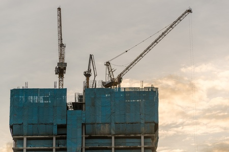 Construction site with crane and building in bangkok thailand photo