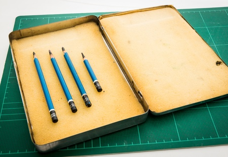 ee: Pencil drawing EE in the box on the green Cutting mats