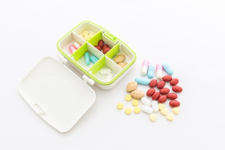 colorful pills and Cartridges on white background