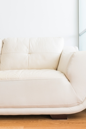 white sofa near glass partition and white wall photo