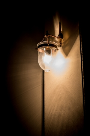 Lighted classic sconce on the wall Stock Photo - 24642077