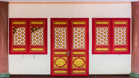 red wooden door with chinese traditional style pattern