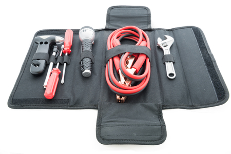 Emergency kit , car jack, jumper cables for car on white back ground photo