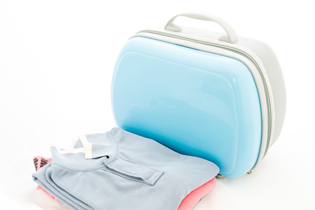 Clothing , blue suitcase for travalling on white background Stock fotó