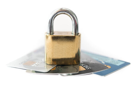 Credit cards and lock, business security on white background photo