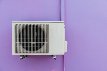Air compressor on purple wall photo