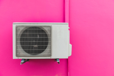 red pink: Air compressor on red pink wall