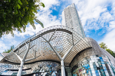 SINGAPORE - JUNE 18 : Day view of ION Orchard shopping mall onJUNE 18, 2014 in Singapore Orchard Road. The Media Facade is a multi-sensory canvas media wall made with cutting-edge technology. Editorial